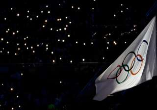 Smartphone lights illuminate the ranks behind the Olympic flag during the closing ceremony in the Maracana stadium at the 2016 Summer Olympics in Rio de Janeiro, Brazil.