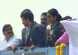 P V Sindhu flashes her silver medal during the victory parade.