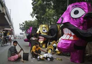 Artistans prepare effigies of the 10-headed demon Ravan in preparation for the upcoming Dussehra festival in New Delhi. The effigies will be burned during the festival, symbolising the victory of good over evil.