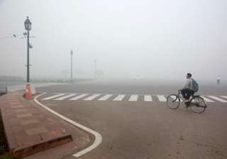 A cyclist rides on a road enveloped by smoke and smog, on the morning following Diwali festival in New Delhi, India, Monday, Oct. 31, 2016. As Indians wake Monday to smoke-filled skies from a weekend of festival fireworks for the Hindu holiday of Diwali, New Delhi's worst season for air pollution begins, with dire consequences. A new report from UNICEF says about a third of the 2 billion children in the world who are breathing toxic air live in northern India and neighboring countries, risking serious health effects including damage to their lungs, brains and other organs.