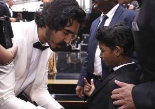 Dev Patel was also seen sharing an adorable moment with little Sunny Pawar. He was captured adjusting the suit of the 'Lion' actor. Little Sunny was selected from 2,000 children to play the character of Saroo Brierley in the film.