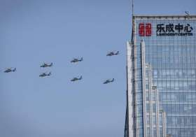 Chinese Z 19 military helicopters fly in formation during a- India Tv