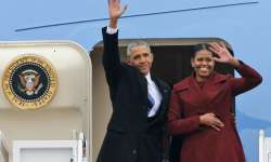 Barack Obama and his wife Michelle wave as they leave- India Tv