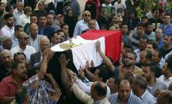 People carry the coffin of a policeman killed in an ambush