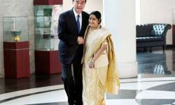 Sushma Swaraj and her Chinese counterpart Wang Yi exchange