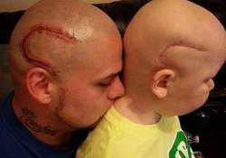 Dad gets matching tattoos as his son