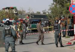 Police inspect at the site of suicide attack near Afghan