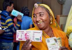 A rural woman senior citizen after exchanging Rs 500 and- India Tv