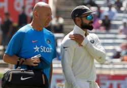 Virat Kohli walks off the field after suffering shoulder