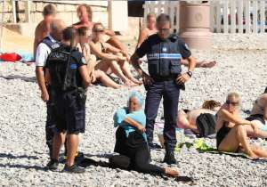 Armed men in France's Nice force burkini-clad woman to- India Tv