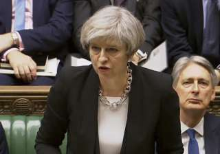 British PM Theresa May addressed lawmakers in...
