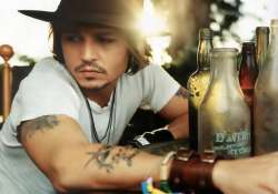 johnny depp wants to frame his tattoos as memoir