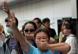 protesters flash hunger games sign at thai pm