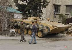 syrian forces mass outside rebel stronghold.