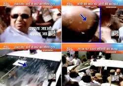 andhra home minister s supporters throw rotten eggs