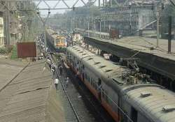suburban train services hit in mumbai as angry commuters