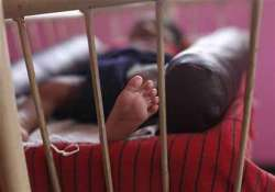 infant girl found dead in her cradle with rope round her