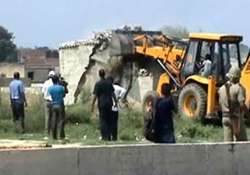 stoning as greater noida bulldozers demolish illegal houses