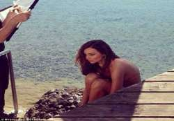 miranda kerr strips for a swimsuit shoot in freezing cold