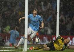 city beats villa 4 0 in sight of epl title