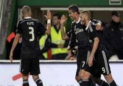 ronaldo scores to help madrid win 2 0 at elche extend lead