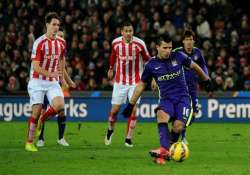 aguero s double guides man city to 4 1 win at stoke