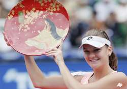 radwanska beats zvonareva to win pan pacific open