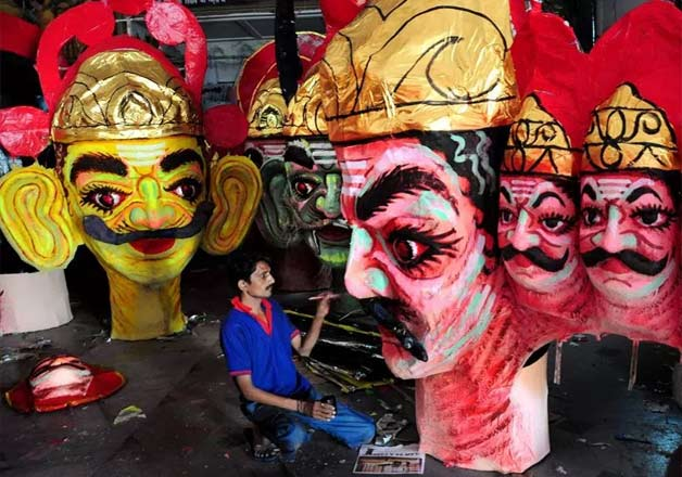 Dussehra or Vijaydashmi, the festival which marks the symbol of victory of good over evil, is being celebrated across the nation with great zeal. Click through for a glimpse of how the festival is being celebrated. In pic an artist paints an effigy of Ravan in Nagpur.