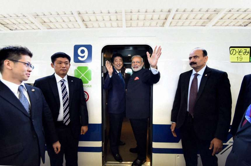 Prime Minister Narendra Modi and his Japanese counterpart Shinzo Abe boarding the Shinkansen bullet train at Tokyo Station in Japan on Saturday.