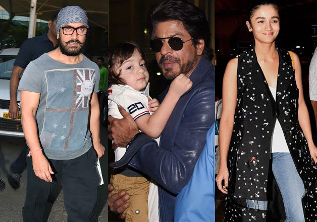 Trust superstar Shah Rukh Khan's youngest child AbRam to steal limelight from renowned personalities of film industry and he wouldn't disappoint. The little munchkin was cradled in his father's arms when they were at the International Airport of Mumbai and looked awesomely cute. Yesterday, was a busy day for paparazzi at the airport with many celebrities including megastar Rajinikanth, superstars Aamir Khan, Hrithik Roshan, actress Alia Bhatt and others traveling. It, however, needs to be added that AbRam nestled comfortably in SRK's arms hogged the maximum attention. Have a look at the pictures.