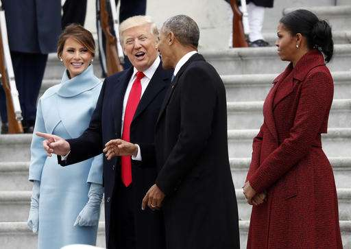 President Donald Trump and first lady Melania Trump talk with former President Barack Obama and Michelle Obama during a departure ceremony on the East Front of the U.S. Capitol in Washington