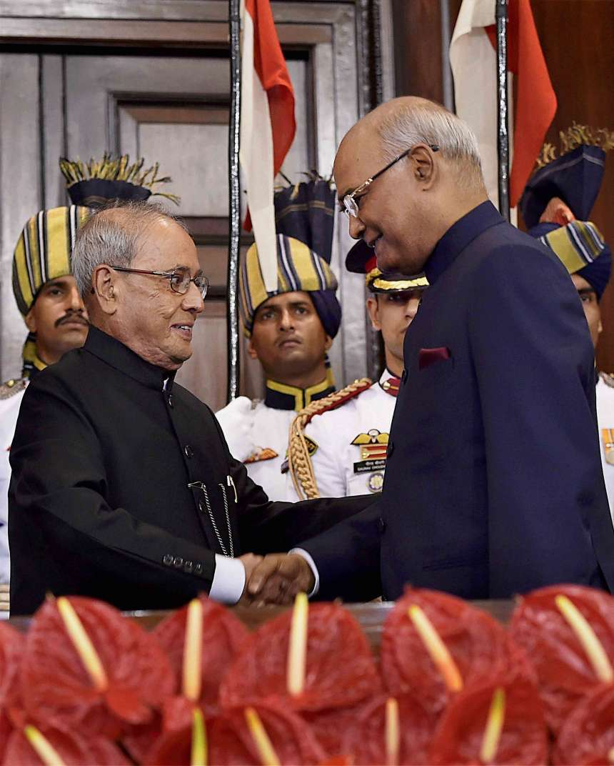 Newly appointed President Ram Nath Kovind and his predecessor Pranab Mukherjee exchanging chairs after the former took oath at a special ceremony in the Central Hall of Parliament