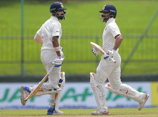 Shikhar Dhawan and Lokesh Rahul run between the wickets during the first day's play of the third Test against Sri Lanka in Pallekele