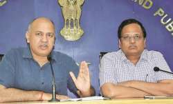 Delhi's Deputy Chief Minister Manish Sisodia along with