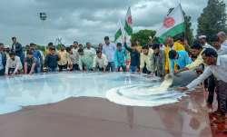 Swabhimani Shetkari Sanghatana activists pour milk at the