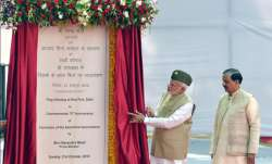 Prime Minister Narendra Modi unveils a plaque as Minister