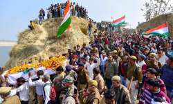 People attend the funeral procession of CRPF jawan Mahesh