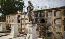 Even the dead aren't safe in Maracaibo, a sweltering,