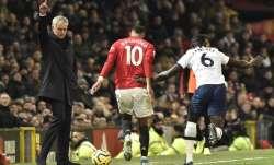 Tottenham's manager Jose Mourinho, left, reacts as
