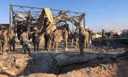 US soldiers stand at the site of Ain al-Asad air base in