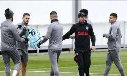 Atletico Madrid's head coach Diego Simone, second right,