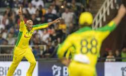 Australia's bowler Ashton Agar celebrates with teammates