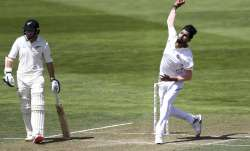 Ishant Sharma of India bowls while Tom Latham of New