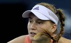 Kazakhstan's Elena Rybakina returns the ball to Croatia's
