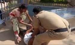 Caught on cam: Telangana cop kicks grieving father after