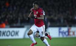 Manchester United's Anthony Martial, front, vies for the