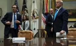 Treasury Secretary Steven Mnuchin and President Donald Trump listen to a question during a conferenc