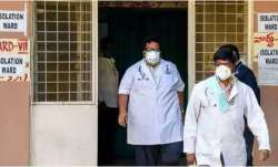Hospital staff is seen outside the Special Isolation Ward
