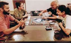 Anushka Sharma, Virat Kohli compete in a game of monopoly with their parents