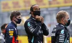 Mercedes driver Lewis Hamilton of Britain, center, stands